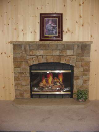 Classic Fieldstone Fan With Stone Mantel