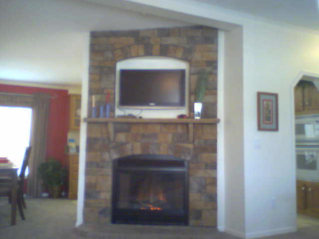 MESQUITE STONE AND TV SURROUND WITH STONE MANTEL