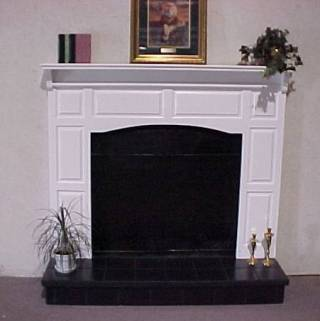 Raised Panel Surround With Raised Black Tile Hearth